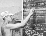 Canadian serviceman updates flight information at Ismailia, Egypt (28 October 1974).